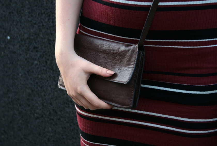 Closeup of my brown leather bag and nude nails
